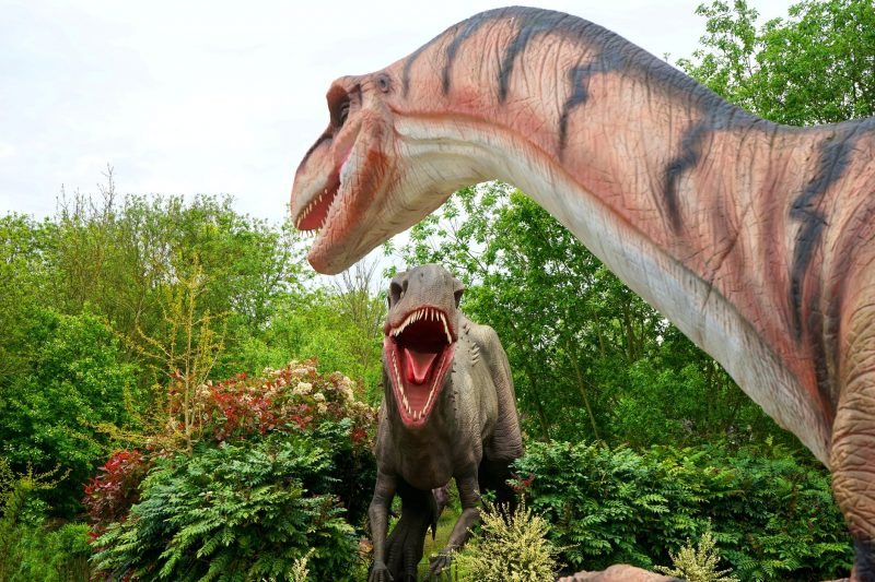 two dinosaur statues