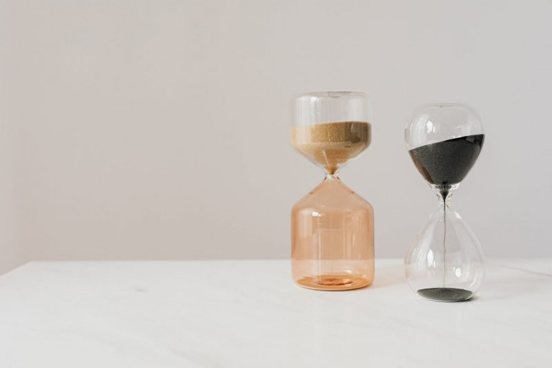 stylish various sand hourglasses placed on table